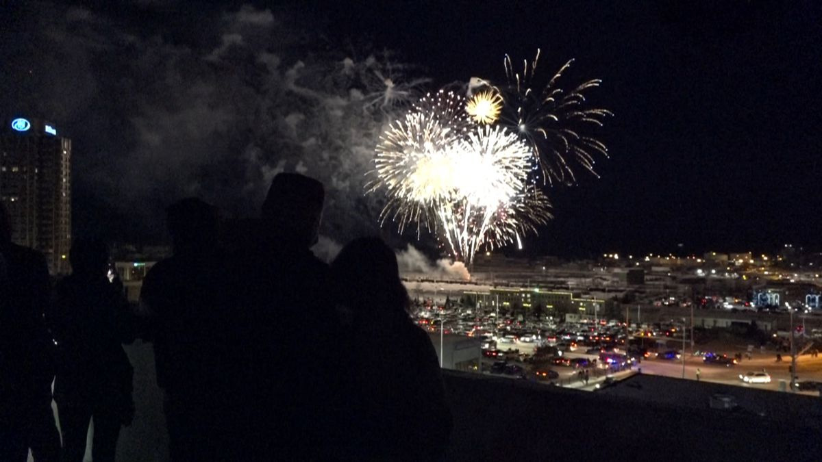 A view of the fireworks from the 5th Avenue parking garage in Downtown Anchorage as folks rang...