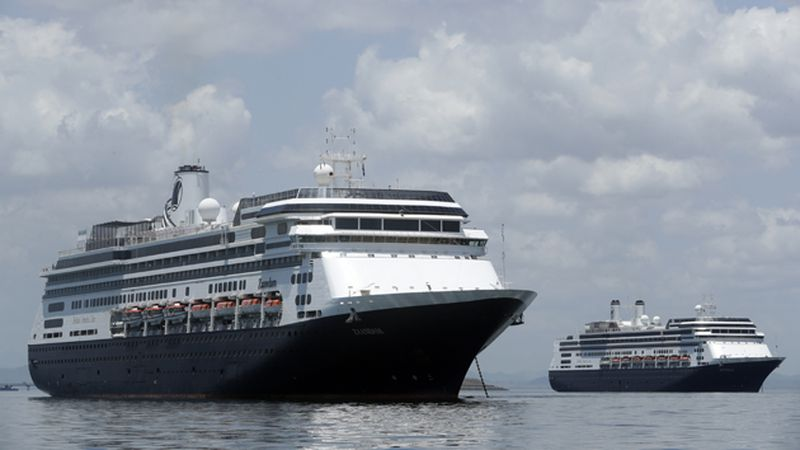 The Zaandam cruise ship, left, is anchored shortly after it arrives to the bay of Panama City,...