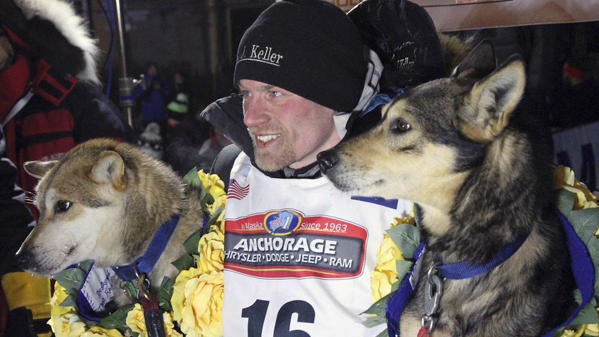 FILE - In this March 15, 2016, file photo, Dallas Seavey poses with his lead dogs Reef, left,...