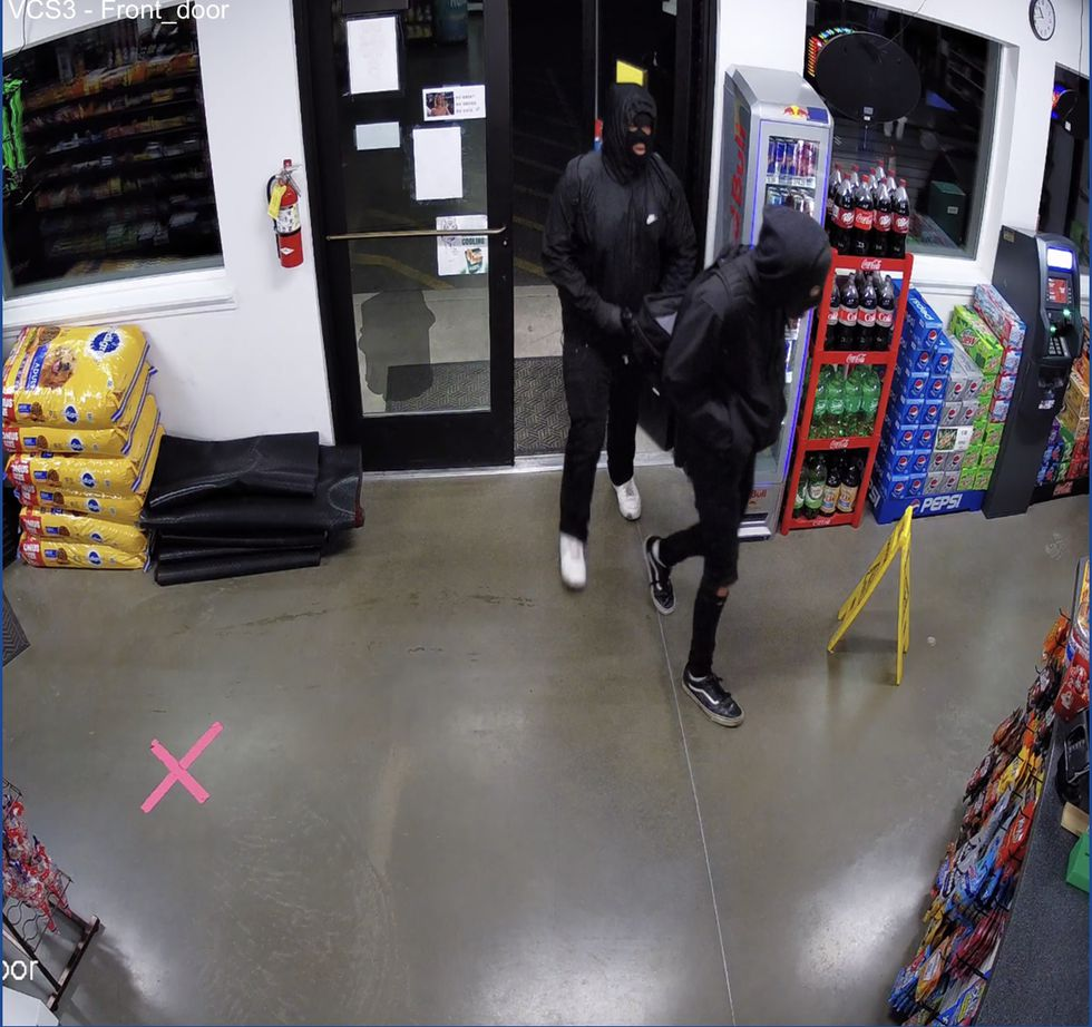 Surveillance images captured at Valley Country Store in Palmer on August 24, 2020, show masked suspects robbing the business at gunpoint. (Courtesy: Matt Gittlein)