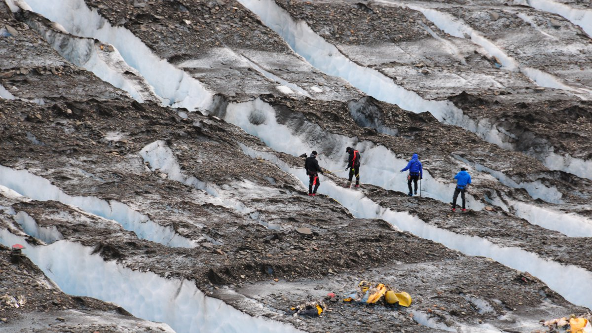 A recovery team searches for aircraft wreckage of the C-124 Globemaster on Colony Glacier. (DoD...