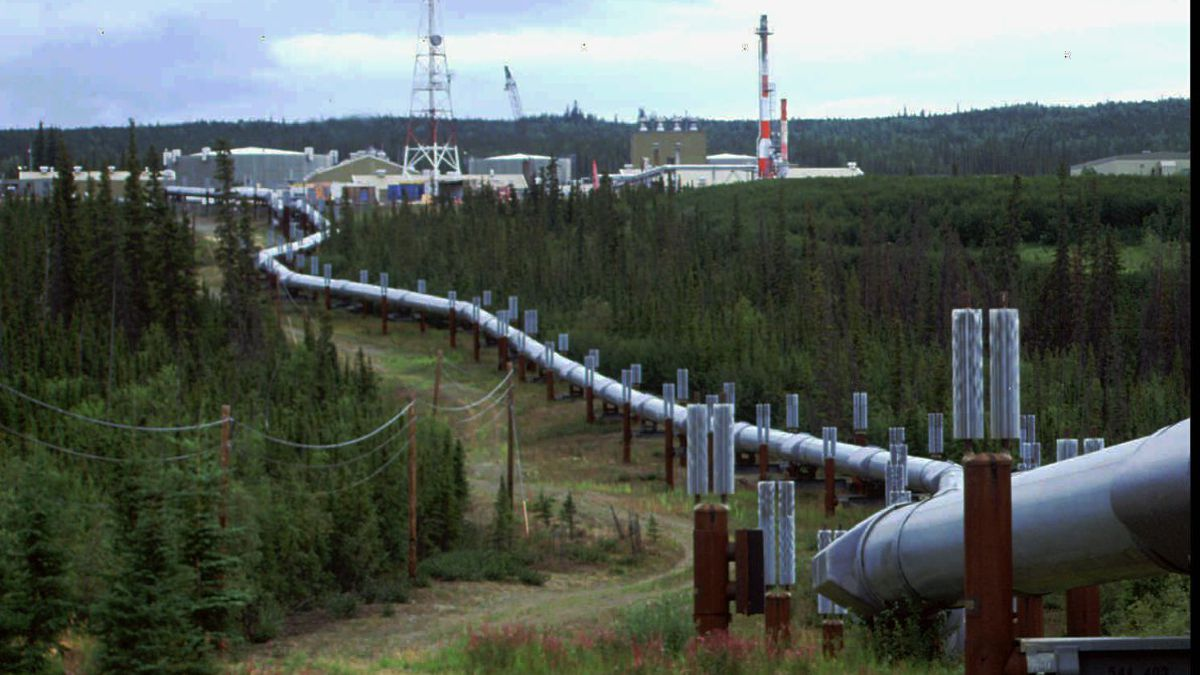 The Trans-Alaska pipeline and pump station north of Fairbanks is shown in this undated file photo. The 800-mile Trans-Alaska pipeline carries Alaska North Slope crude oil from Prudhoe Bay south to Valdez. President Clinton signed a bill in November lifting the ban on export of North Slope oil.  (AP Photo\Al Grillo)