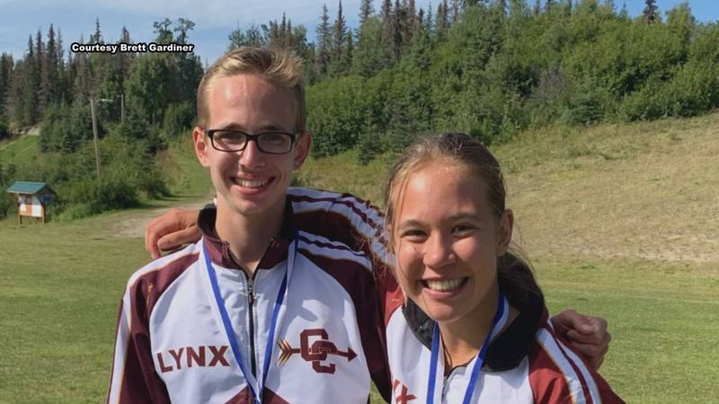 Dimond High School cross-country runners Jared Gardiner and Emily Erickson after medaling the...