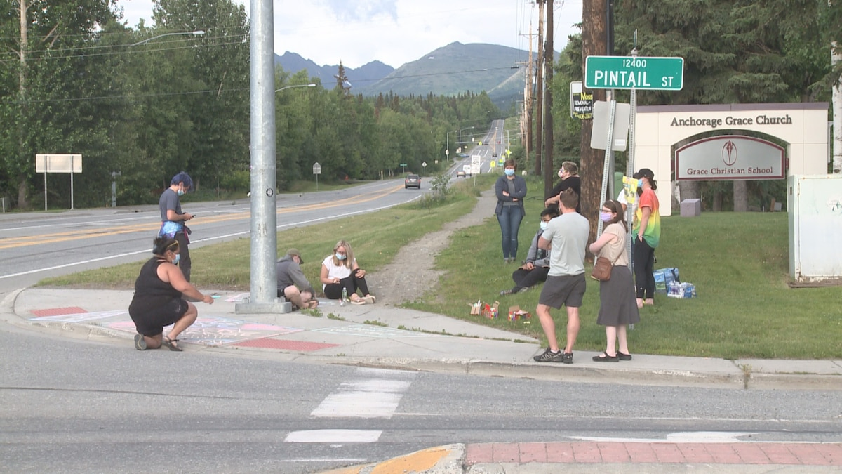 Former students and teachers gathered outside Grace Christian School Saturday to share...