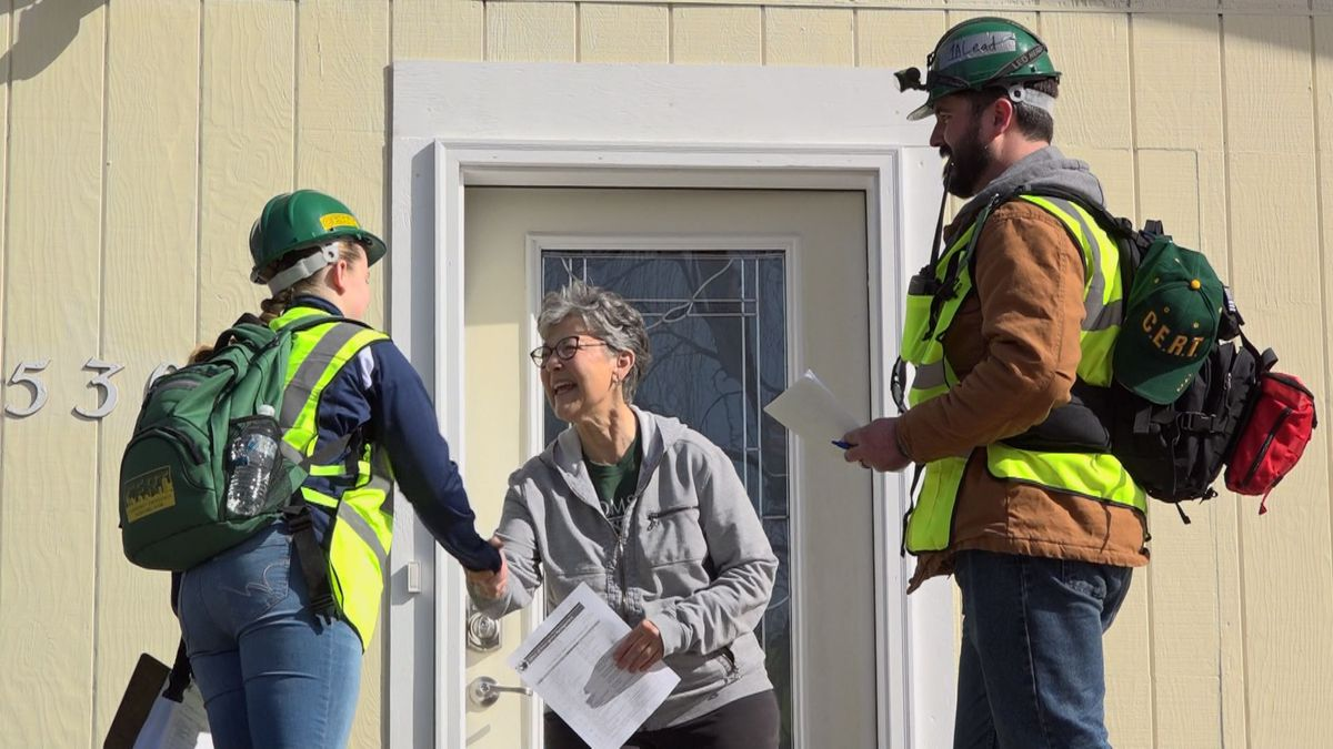 A Community Emergency Response Team (CERT) checks in with a Kenai resident during a mock evacuation scenario.