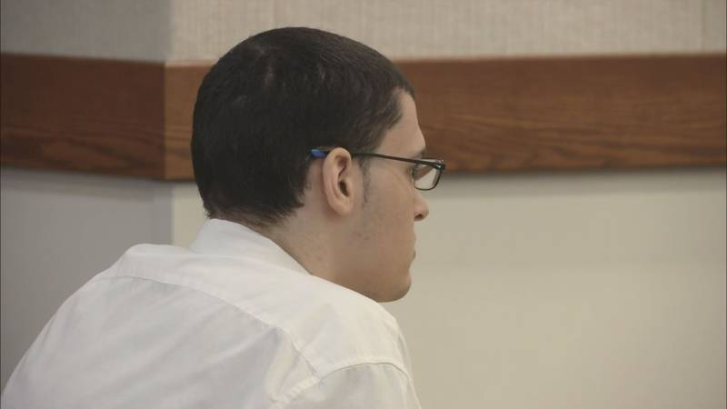 Dominic Johnson sits in court on the first day of his trial for murder. (KTUU)
