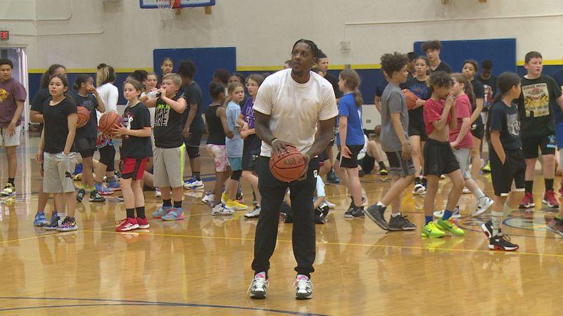 NBA champion Mario Chalmers hosting a youth clinic at Bartlett High School in Anchorage, Alaska.