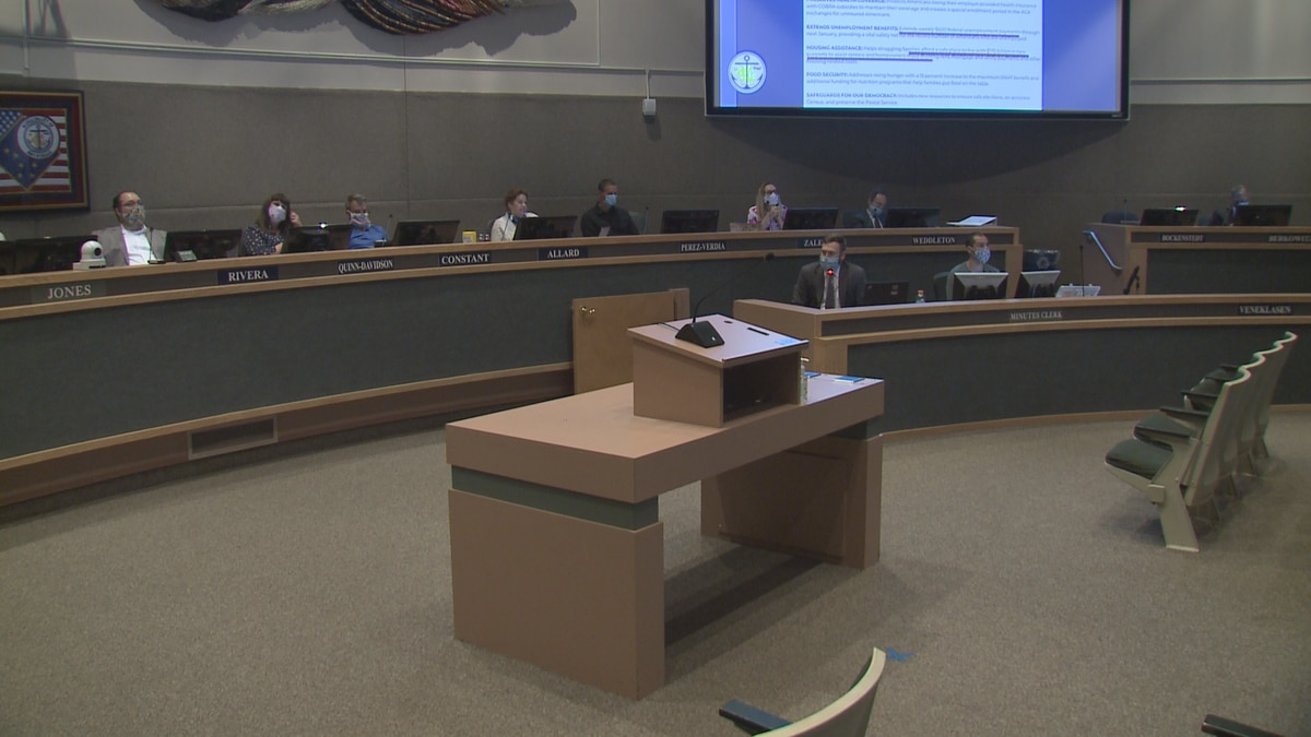 Anchorage Assembly members listen to a presentation from the administration.
