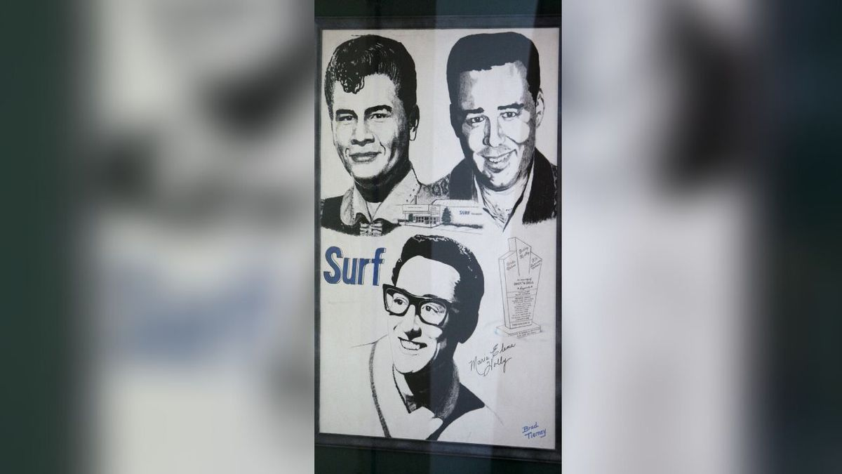 "A poster showing Buddy Holly, Ritchie Valens and J.P. ""The Big Bopper""..."