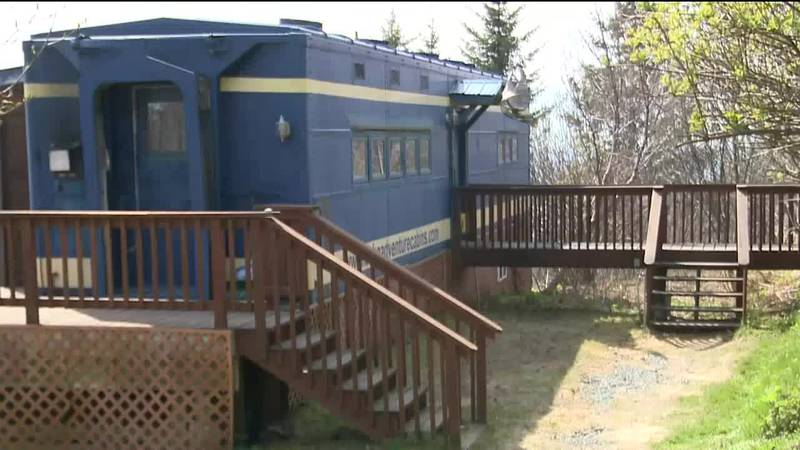 On a hillside in Homer sits a train car that is seemingly wildly out of place and yet, if...