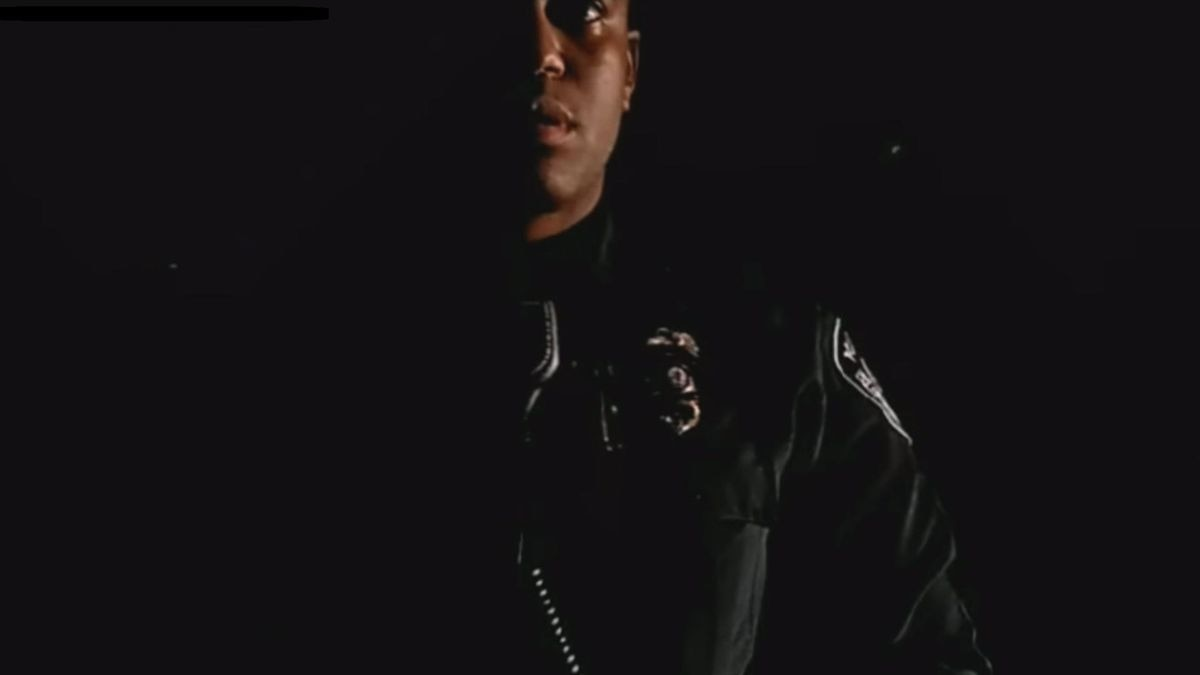 Officer Cornelius Pettus approaches a bicyclist the night of Sept. 30 (Image courtesy Northern Corruption Monitor 907)