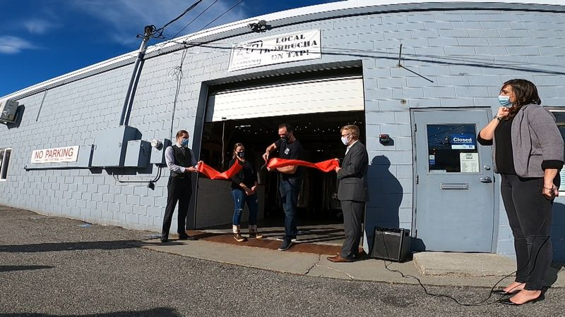 Jessie Janes cuts the ribbon beside his wife Amanda at their brewery where they just started...