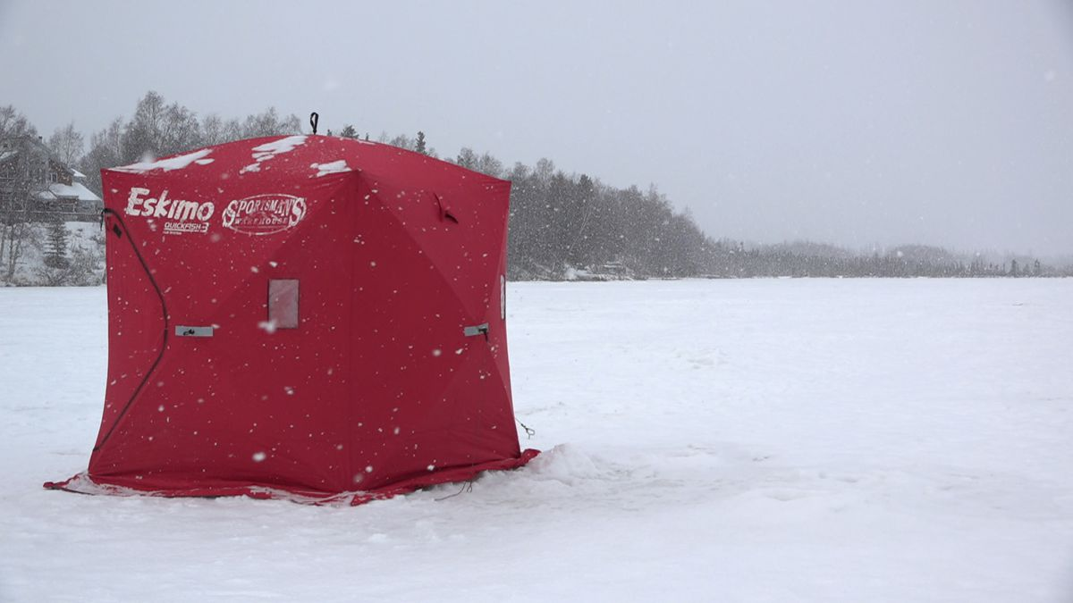 A lone ice fishing tent out on Jewel Lake in Anchorage on a snowy February afternoon.