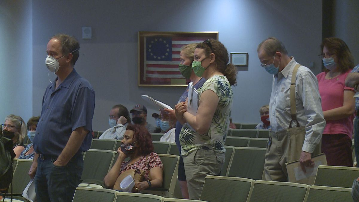 Anchorage residents line up for public comment at an Anchorage Assembly meeting on July 15th, 2020.