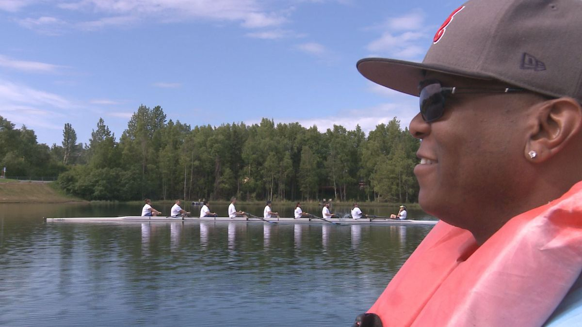 Event participant Michael Bishop watches another boat warm up for a race