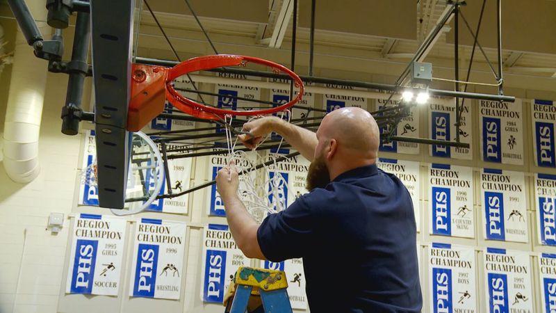 Lumen Christi cuts down the net after winning the 2021 state championship.