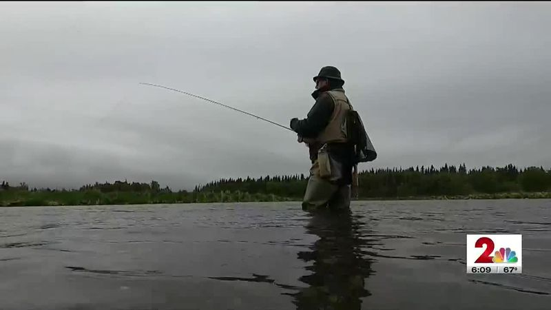 A man fishes in the Brooks River at the Katmai National Park and Preserve.