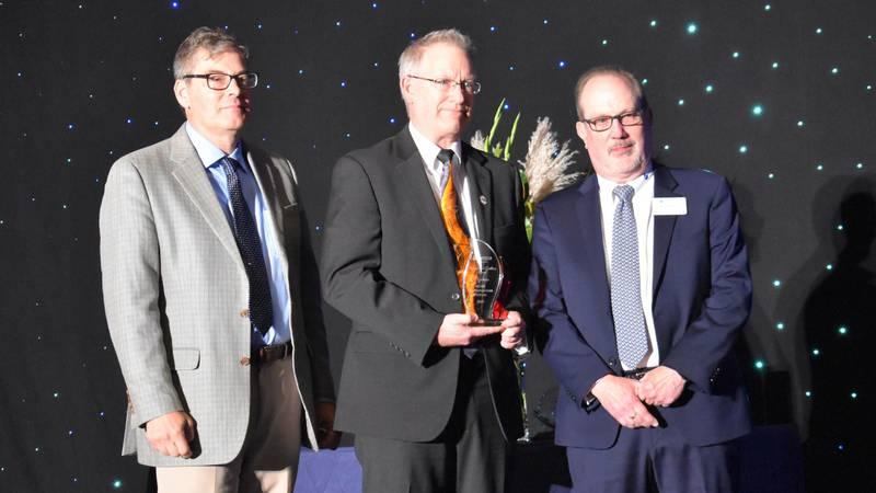 IACMI CEO John Hopkins, center, accepted the SAMPE 2021 Organizational Excellence Award in...