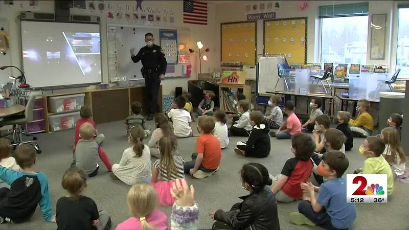 School Resource Officer Mathew Ivacic gives kindergarteners at Ocean View Elementary pointers...