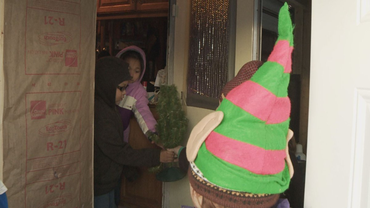Karen Wilson and her granddaughter MK deliver Christmas donations to McKinley Fire victims on...