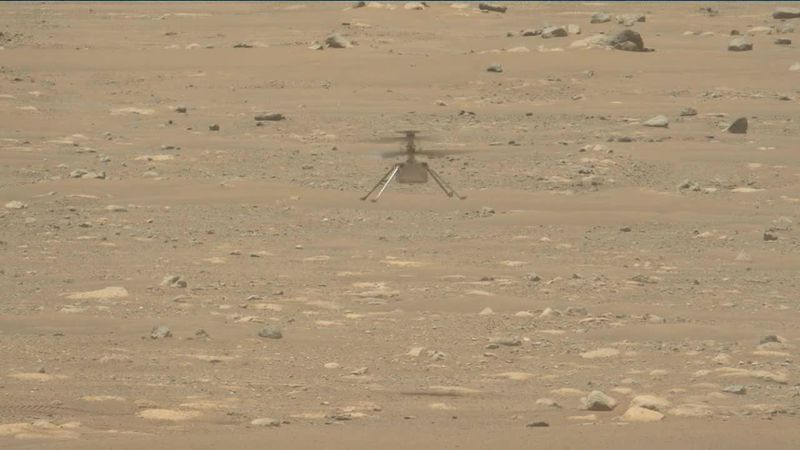 NASA's Ingenuity Mars Helicopter takes off and lands in this video captured on April 19, 2021.