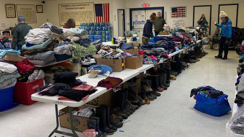 Volunteers prepare supplies donated to those affected by the Haines landslide. Courtesy Lora...