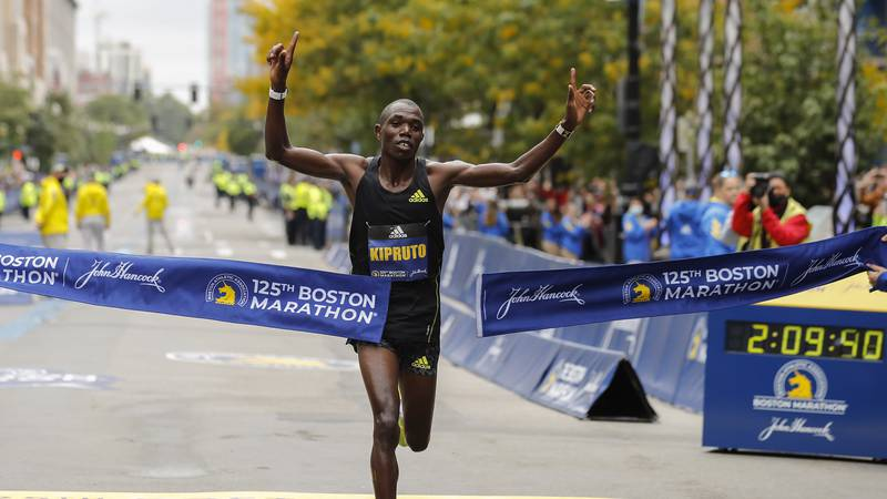Benson Kipruto, of Kenya, breaks the tape to win the 125th Boston Marathon on Monday, Oct. 11,...