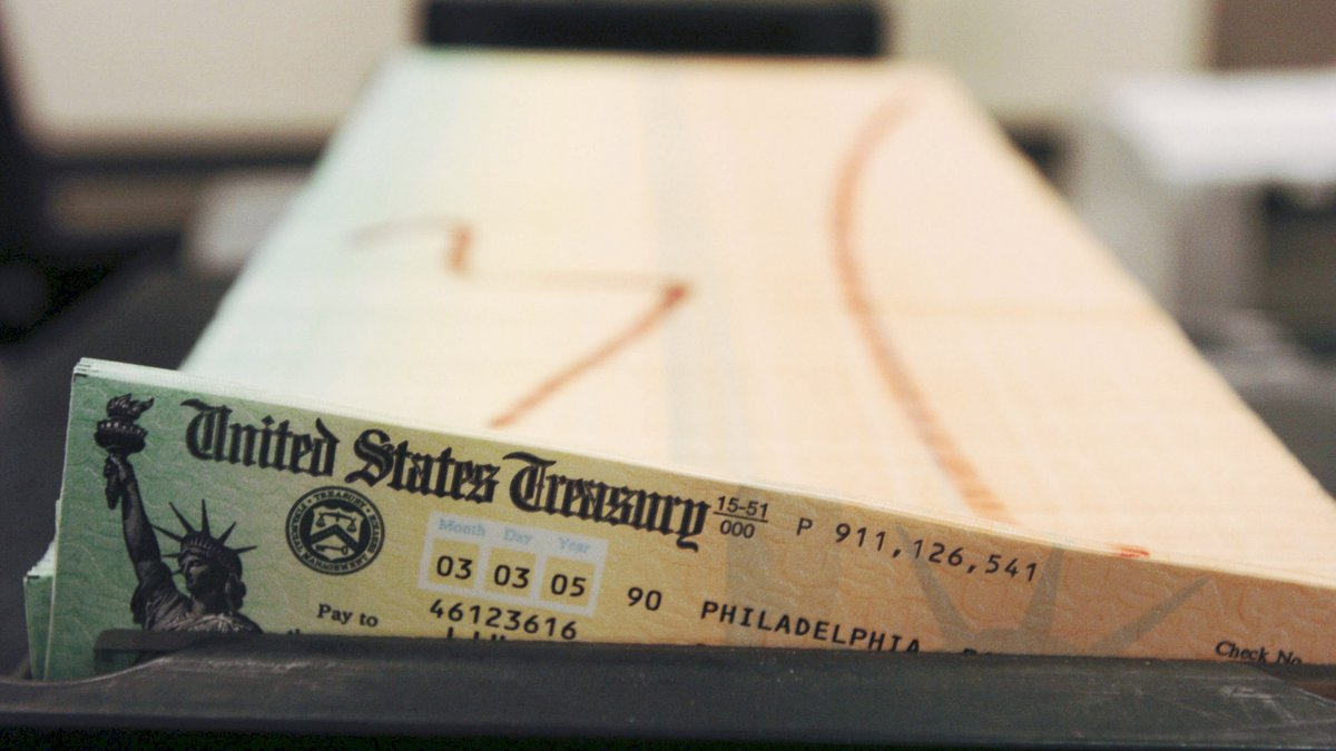 In this Feb. 11, 2005 file photo, trays of printed Social Security checks wait to be mailed...