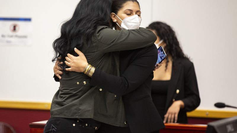 Des Moines Register reporter Andrea Sahouri, facing, hugs her mother, Muna Tareh-Sahouri, after...