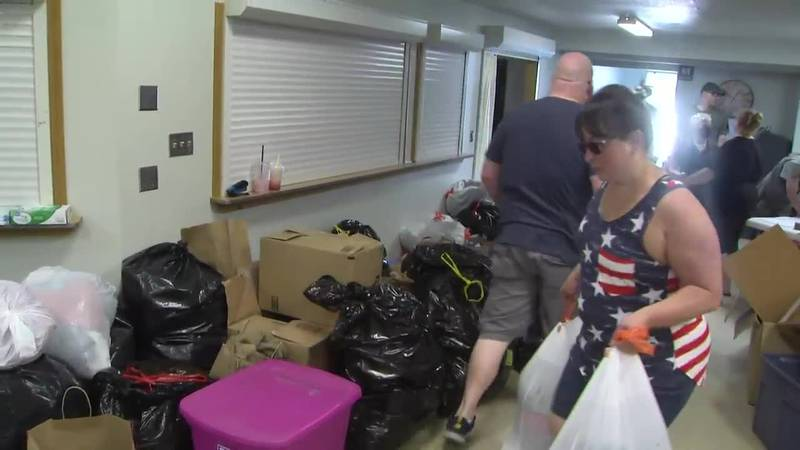 Volunteers drop off donations for fire victims at Eagle River Lions Club