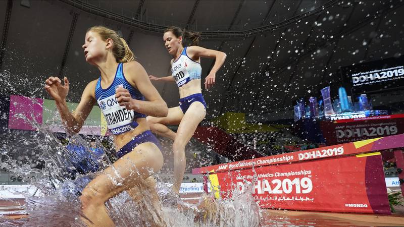 Allie Ostrander, of the United States, left, and Elizabeth Bird, of Britain, right, compete...