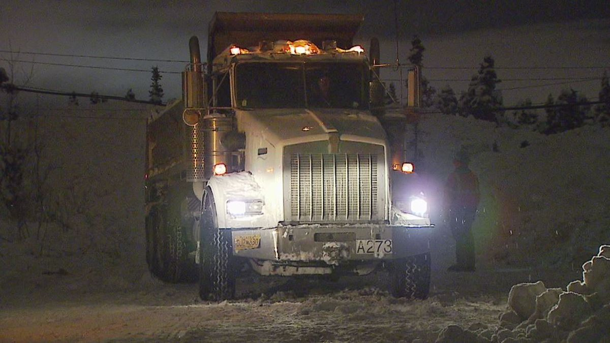 An American Landscaping snow dumping truck, which reportedly pulled down power lines on Dec....