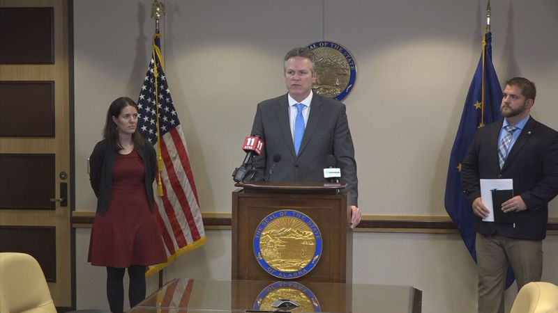 Gov. Dunleavy, Dr. Anne Zink, left, and DHSS Commissioner Adam Crum address the state's plan...