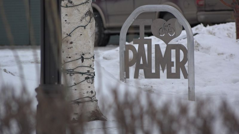 A shot of a bike path sign in Palmer near the town square.