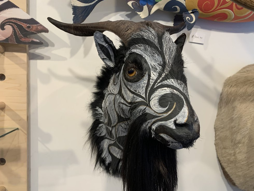 Dodd's hand-painted goat hangs on a wall